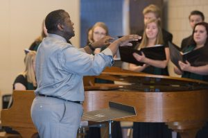 """Dr. Jesse Grant, Associate Vice President of Student Life and Success, led the Bemidji Choir in """"Life Every Voice and Sing."""""""