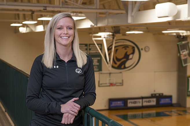 New Bemidji State women's basketball coach Chelsea DeVille in the BSU Gymnasium.