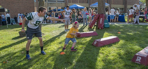 Football players guide young talent at Community Appreciation Day on Sept. 3.