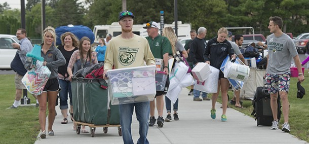Student-athletes help carry belongings into residence halls during Move-In Day on Aug. 21.