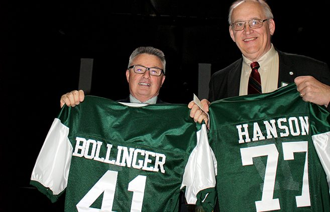 Rob Bollinger   President Richard Hanson with football jerseys they  received in recognition of their contributions to BSU Athletics. 951c15026