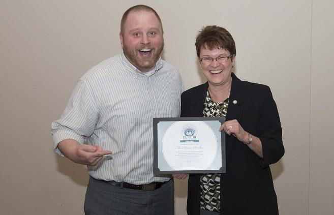 Bob Strand receives the Spirit of BSU Award from President Hensrud on behalf of Diane Renken.