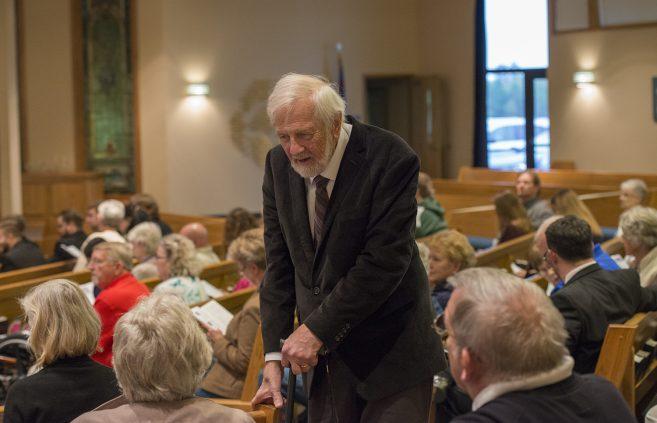 Dr. Paul Brandvik greets audience members.
