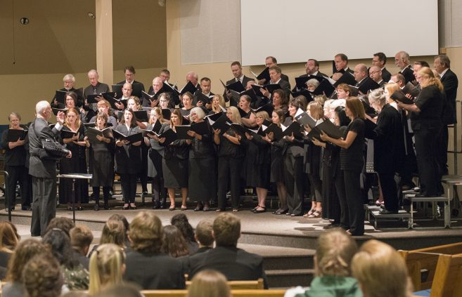 Mark Carlson '75, conductor of the Bemidji Alumni Choir, conducted the concert's first three numbers.