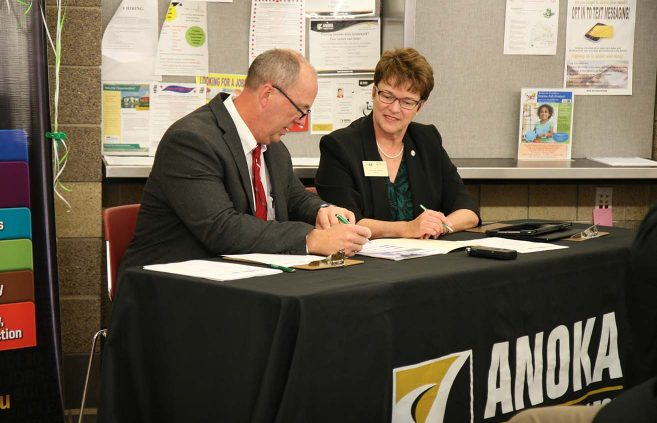 Anoka Technical College President Kent Hanson and BSU/NTC President Faith C. Hensrud sign a series of articulation agreements on Oct. 10.