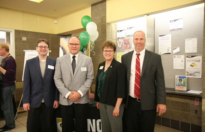 Dr. Michael Lund and Lyle Meulebroeck, assistant professors in BSU's TAD School, with presidents Hensrud and Hanson.