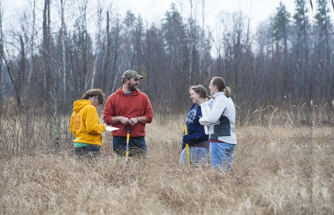Students in a 2014 Wetlands Ecology course log their research at BSU's Hobson Memorial Forest.