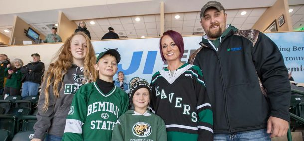Norbord employee Nick Brown and family members enjoy the Beavers' Oct. 15 win over Alaska Anchorage.