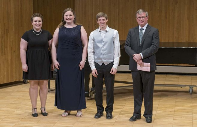 2018 DeKrey Scholarship winners (L to R) Hannah Jenson, Savanna Hagerty and Evan Byler with Dan DeKrey.