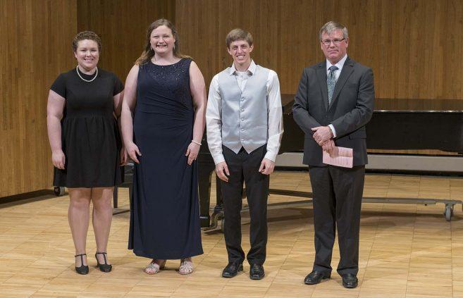 2018 DeKrey Scholarship winners (L to R) Hannah Jenson, Savanna Hagerty and Evan Byler with Dan DeKrey.