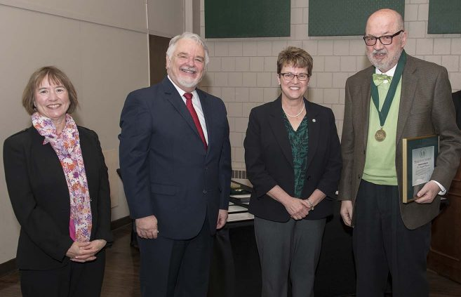 Dr. Dragoljub Bilanovic (far right) was named professor emeritus of environmental studies. He's pictured with (L to R) VP Karen Snorek, VP & Provost Tony Peffer and President Hensrud.