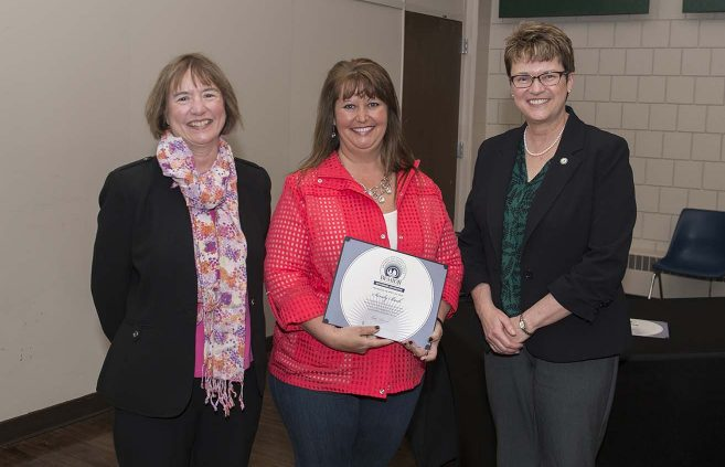 Sandy Beck (center) was recognized for 25 years of service, won an Outstanding Contribution Award and received a Diversity Certificate. She's pictured with VP Karen Snorek (left) and President Hensrud.