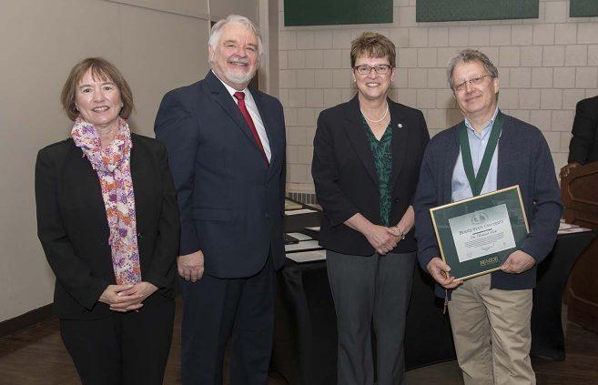 Dr. Richard Hook (far right) was named professor emeritus of psychology. He's pictured with (L to R) VP Karen Snorek, VP & Provost Tony Peffer and President Hensrud.