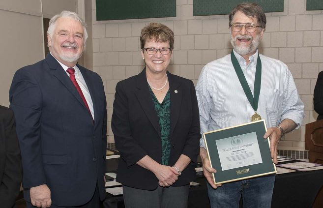 Dr. Tim Kroeger (far right) was named professor emeritus of geology. He's pictured with (L to R) VP Karen Snorek, VP & Provost Tony Peffer and President Hensrud.