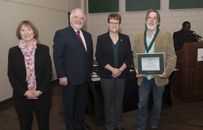 Dr. Mike Morgan (far right) was named professor emeritus of English. He's pictured with (L to R) VP Karen Snorek, VP & Provost Tony Peffer and President Hensrud.