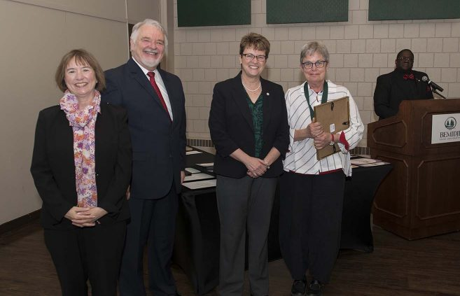 Dr. Carol Nielsen (far right) was named professor emerita of business administration and also won a BSU Distinguished Service Award. She's pictured with (L to R) VP Karen Snorek, VP & Provost Tony Peffer and President Hensrud.