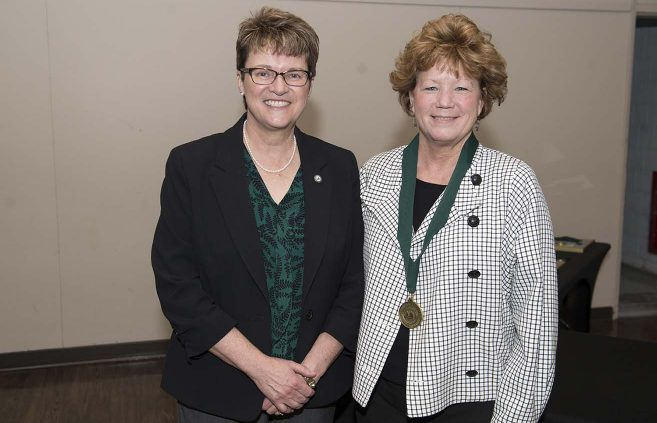 Marla Patrias (right), executive director of BSU Alumni & Foundation, is retiring in May after 20 years at BSU. She's pictured with President Hensrud (left).