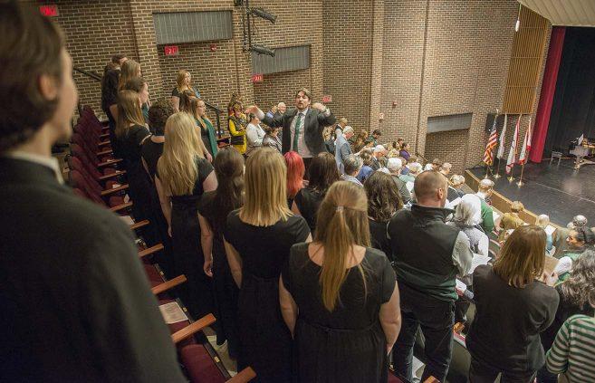 Dr. Dwight Jilek directs the Bemidji Choir at the kickoff celebration.