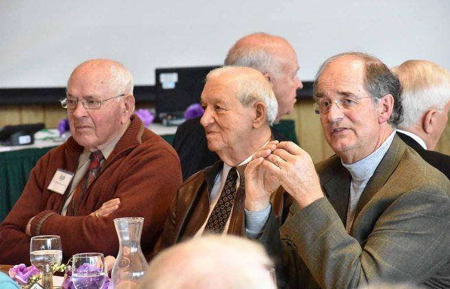 "Former president Jim Bensen (left), legendary men's hockey coach R.H. ""Bob"" Peters (center) and former President Jon Quistgaard at the alumni luncheon."