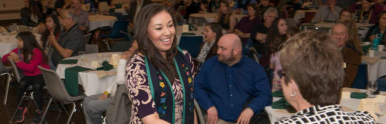 Naomi Johnson was greeted by President Hensrud after receiving her commencement stole at the American Indian Students Recognition Banquet on April 19.