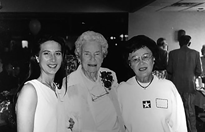 Suzy (Christianson) Langout, left, and her mother, Marion Christianson, right, join Dr. Myrtie Hunt at an event in her honor.