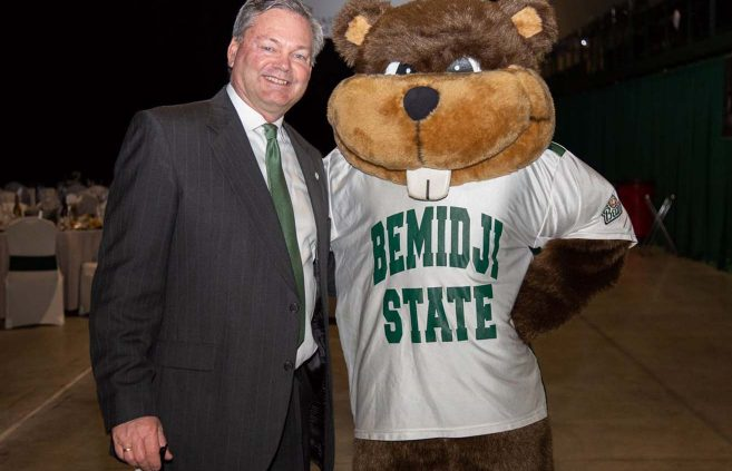 Director of Athletics Tracy Dill and Bucky.