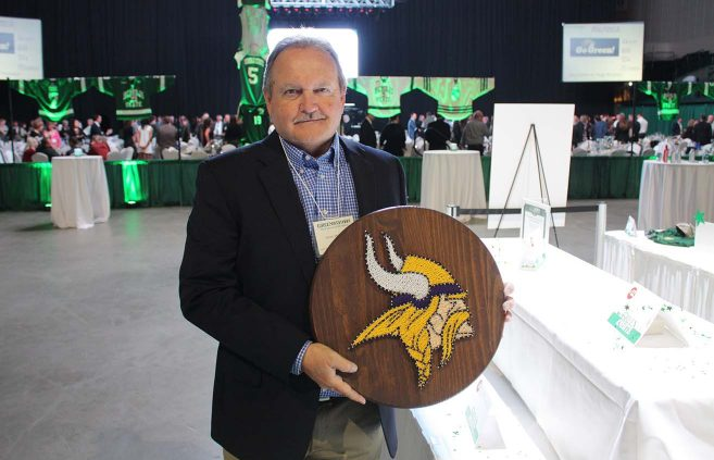 Jim McElmury '71 with his silent auction purchase.