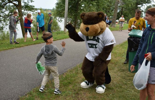 Bucky greets a fan prior to the Parade of Teams