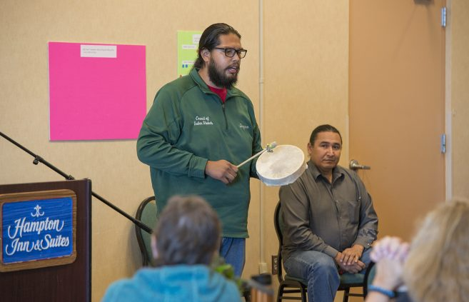 Brandon Quagon, a BSU freshman from Duluth, Minn. pursuing a degree in indigenous studies, facilitates cultural immersion drumming experience to open and close international conference held in Bemidji.