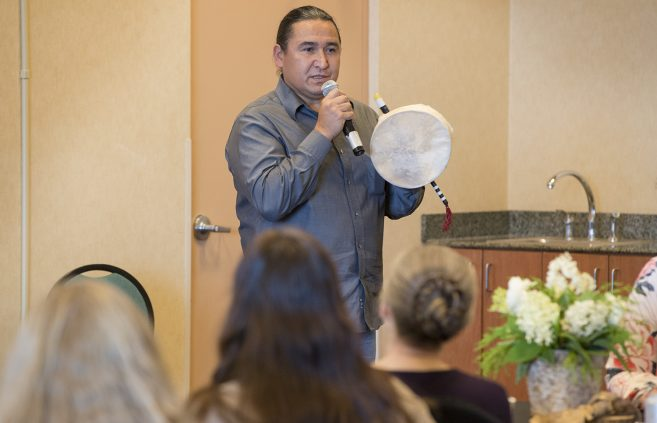 Buck Jourdain of Red Lake, Minn., facilitates a cultural immersion drumming experience to open and close international conference held in Bemidji.