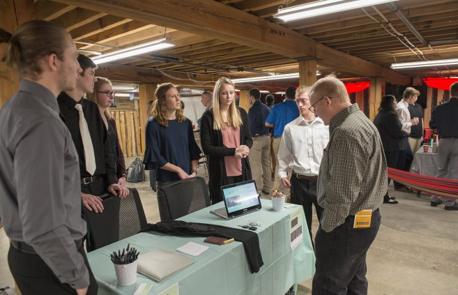 Bemidji State University marketing students presenting their original projects to local entrepreneurs