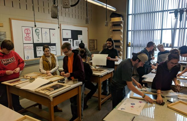 BSU Students participating in a TAD school woodpress workshop