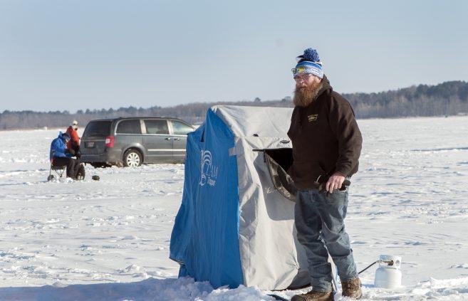 Participants enjoy ice fishing on Lake Bemidji.