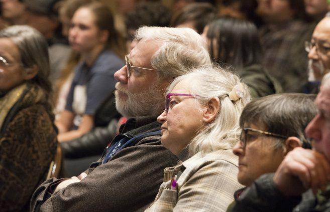 Audience members.