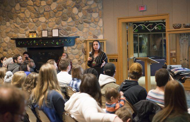 Audience members listening to Winona.