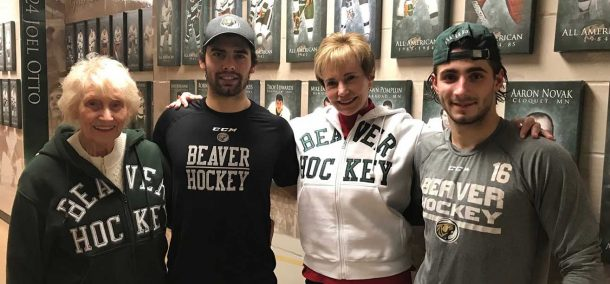 L to R: Cay Emkovik, sophomore men's hockey forward Ethan Somoza, Cait Griffen, sophomore men's hockey forward Aaron Miller