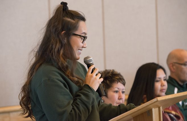Student Raven Peltier moderating the Native American Health panel discussion.