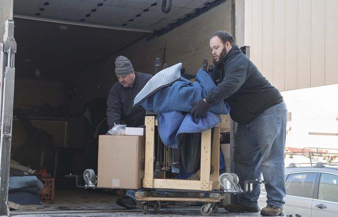 Schmitt's Music crew unloading BSU's Model B.