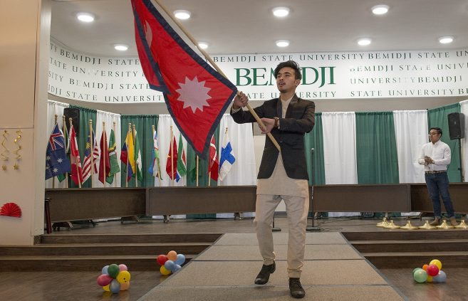 During a flag processional, students highlighted their home countries.