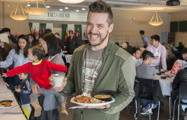 Mitch Blessing, assistant professor of technology, art and design, enjoying a meal featuring foods from across the globe.