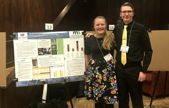 BSU students Ali Chalberg and Brad Morris with their project at the Minnesota State Undergraduate Scholars Conference.