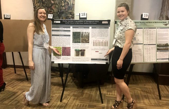 BSU students Nikki Shaw and Mattie Osborn with their project at the Minnesota State Undergraduate Scholars Conference.