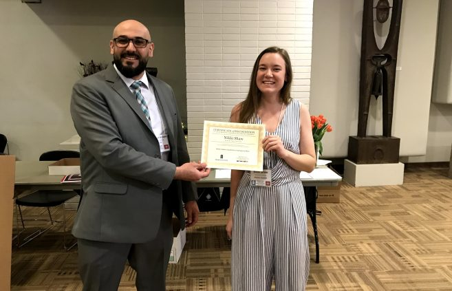 Dr. Mahmoud Al-Odeh, associate professor of technology, art and design and conference director and Nikki Shaw, BSU student at the Minnesota State Undergraduate Scholars Conference.