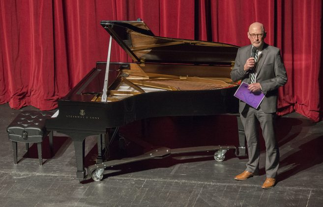 Dr. Jim Barta, dean of the College of Arts, Education and Humanities, addresses the crowd at the Steinway reception.