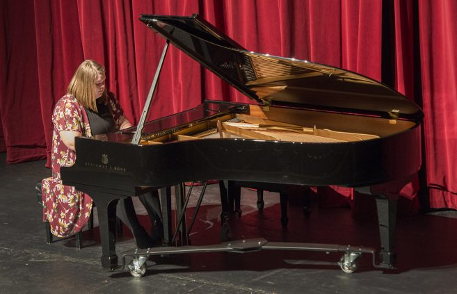"Katilyn Huhta, a junior from Sebeka Minn. majoring in music education, plays ""Waltz in A minor, op. 32, no.2"" by Frederic Chopin, at the Steinway reception."