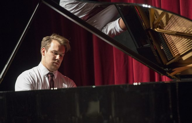 "Ben Larson, a senior from Solway, Minn. majoring in music, plays ""Reflets dans l'eau"" at the Steinway recital."