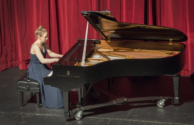 "Angelica Novinger, a senior from Bemidji, plays ""Ballade no. 3 in A-flat major, op.47"" by Frederic Chopin at the Steinway reception."
