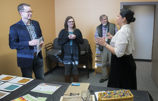 Students highlight their produce, Flare Fabric, a fabric designed to produce solar energy during use, to local entrepreneurs.