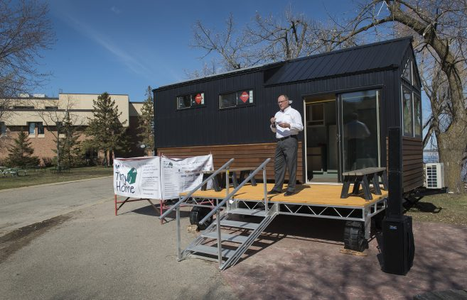 Lyle Meulebroeck, assistant professor of technology, art and design, emceed the tiny house ribbon cutting ceremony.