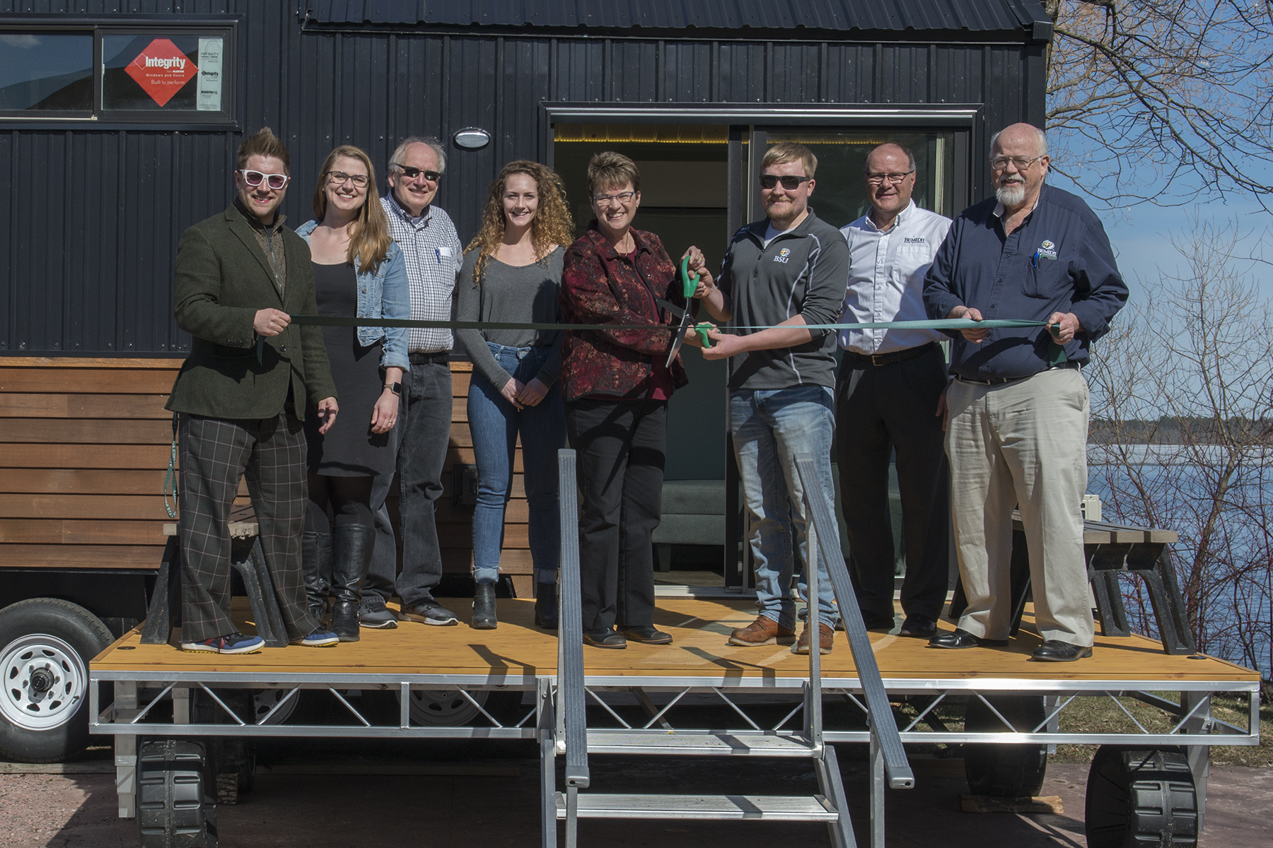 BSU Students, faculty and staff cut a ribbon at the completion of the tiny house